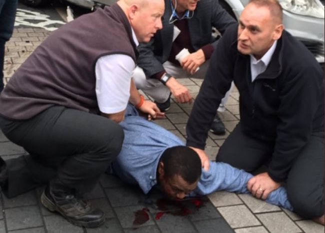 A man is held down after a car was driven into pedestrians outside a London Museum Saturday. (Twitter photo)