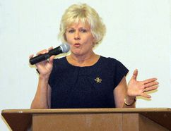 Renfrew-Nipissing-Pembroke MP Cheryl Gallant speaks to a crowd gathered at a tax information session in Cobden recently. She said proposed changes to the tax system will be bad news for Canadians.