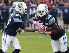 Toronto Argonauts QB Ricky Ray (15) hands off to James Wilder Jr. during the first half at BMO Field in Toronto on Saturday October 7, 2017. (Jack Boland/Toronto Sun/Postmedia Network)