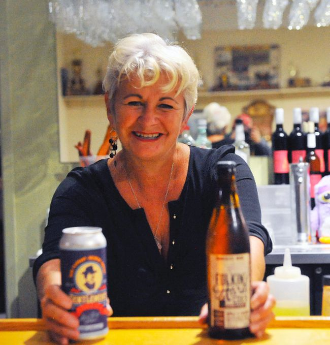 Laurie O'Neill of Paris, bartender at this year's Norfolk Craft Brew Lounge at the Norfolk County Fair and Horse Show, shows off two of the local selections on the 2017 menu. Now in its second year, the lounge is a hit with fairgoers. JACOB ROBINSON/Simcoe Reformer