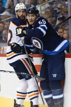 Edmonton Oilers' Eric Gryba (62) and Winnipeg Jets' Mark Scheifele (55) watch the puck during second period NHL pre-season game action in Winnipeg on Wednesday, September 20, 2017. THE CANADIAN PRESS/John Woods
