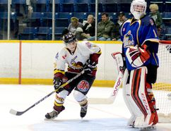 Timmins Rock forward Jordan Picard cuts in front of Gold Miners goalie Ryan Winter during the second period of Saturday night's NOJHL game at the Joe Mavrinac Community Complex. Picard, a Timmins native who was acquired from the French River Rapids in exchange for forward Donny Schultz, was held off the scoresheet as the Rock dropped a 3-1 decision to the Gold Miners. With five goals and eight assists on the season, Picard is tied for 13th place in the NOJHL scoring race. THOMAS PERRY/THE DAILY PRESS