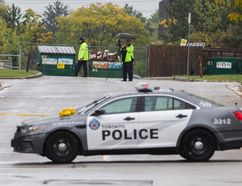 Toronto Police at the scene of a triple shooting outside Kingsview Village Junior School that left one man dead, on Monday, Oct. 9, 2017. (Ernest Doroszul/Toronto Sun)