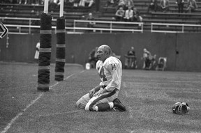 In this Sept. 20, 1964, file photo, New York Giants' Y.A. Tittle squats on the field after being hit hard while passing during a game against the Pittsburgh Steelers. (AP Photo/Dozier Mobley, File)