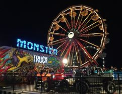 The midway rides and games lit up the sky at the Norfolk County Fair and Horse Show on Saturday night. (Kim Novak/Simcoe Reformer)