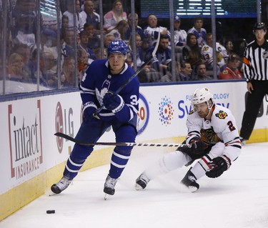 Leafs Auston Matthews and Duncan Keith as Leafs host Chicago at the ACC in Toronto on Monday October 9, 2017. Michael Peake/Toronto Sun/Postmedia Network