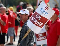Striking CAMI workers walk the line in Ingersoll on Sept. 28, 2017. (Postmedia Network)
