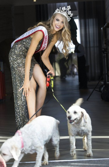 Toronto's Lauren Howe with her dogs on Sunday, October 8, 2017, the day after she was crowned Miss Universe Canada 2017. (Stan Behal/Toronto Sun)