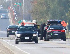 One driver is dead and another is seriously injured after a head-on collision on Queen's Line, east of Tilbury, Ont. that occurred around 7 a.m. on Tuesday, October 10, 2017. Members of the Chatham-Kent Traffic Management Unit are seen here investigating the crash. (Ellwood Shreve/Chatham Daily News)