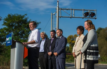 Toronto Mayor John Tory addresses the media regarding the progress of SmartTrack in Scarborough by the tracks on Huntingwood Dr. between Kennedy Rd. and Midland Ave. in Toronto, Ont. on Tuesday October 10, 2017.  Behind from left are - Coun. Chin Lee,  Deputy Mayot Glenn De Baeremaeker, Councillor/ TTC Chair Josh Colle, Ontario MPP's Soo Wong and Tracy MacCharles. Ernest Doroszuk/Toronto Sun/Postmedia Network