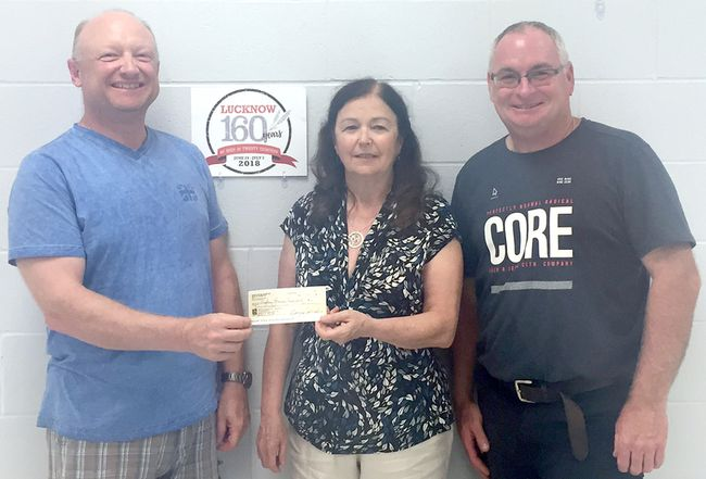 Donna Moffat, a committee member of the 2018 Lucknow Reunion and a former Lucknow & District High School student is shown presenting a cheque in the amount of $400 to the Co-chairs of the 2018 Lucknow Reunion, Luke Smith, left and Glen Gibson, right. The organizers of the Lucknow & District High School Reunion, which had been held every two years, decided not to hold a 2018 school reunion as it would have coincided with the 2018 Lucknow Reunion. The donation was proceeds from the last reunion, held at the farm of Barry and Gladys Johnston, in September 2016.