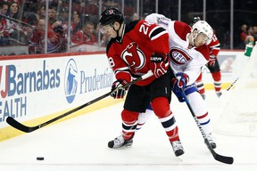 New Jersey defenceman Damon Severson signed a six-year contract last month. He pairs with captain Andy Greene. (JULIO CORTEZ/AP files)