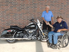 From the right, Glen McLachlan, 65, gives the keys to the winner of the Vanastra and District Lions Club and Vanastra Recreation Centre Harley Davidson Draw, Harvey Livingston. McLachlan is believed by many to be a man that's a key factor in the event's success. (Submitted photo)