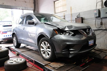 A grey, 2014 Nissan Rogue, with Ontario licence plate BVVH 900, that Toronto Police say was found at an automotive service facility, in Toronto, on Friday, Oct. 6, 2017. It is believed to be the car that struck and killed Debra Graves on a York Mills Rd. sidewalk on Oct. 4. The registered owner of that vehicle is Erin Wright.