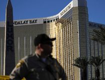In this Tuesday, Oct. 3, 2017 file photo, a Las Vegas police officer stands by a blocked off area near the Mandalay Bay casino in Las Vegas. (AP Photo/John Locher, File)
