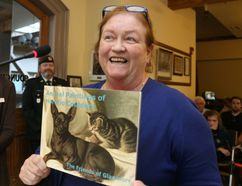 Jason Miller/The Intelligencer Glanmore National Historic Site curator Rona Rustige displays a book of Horatio Couldery's animal art on display at Glanmore, which houses a collection of paintings by Couldery. The book was produced as a fundraising initiative by the Friends of Glanmore. During the 1950s, the family of his brother, Bertram, donated 42 of Horatio's paintings to Belleville. About half depict cats.