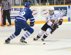 Nick Suzuki of the Owen Sound Attack, right, skates in on Thomas Harley of the Mississauga Steelheads looks on in Ontario Hockey League action at the Harry Lumley Bayshore Community Centre on Saturday, September 30, 2017 in Owen Sound, Ont. (Postmedia Network)