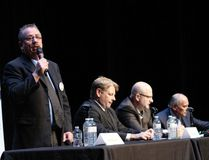 Mayoral candidate Allan Grandison stands up to answer a question at the last mayoral debate before election day, at Holy Trinity High School's theatre on Tuesday, Oct. 10, 2017. Vincent McDermott/Fort McMurray Today/Postmedia Network