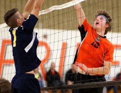 Strathroy's Ryan Grant tries to block a tip from Clarke Road's Gabe Walker during their afternoon match at Clarke Road on Wednesday October 11, 2017. The Trojans won the match 25-13, 25-14, and 25-23. (MIKE HENSEN, The London Free Press)