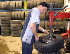 "Maurice Thibeault is seen in this January 2016 Postmedia file photo working as a tire technician at Brooks Tire in Chatham. A former colleague there described him as ""laid back"" as a war over a $6-million winning Lotto 6/49 ticket brews."