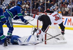 Ottawa Senators' Alex Burrows falls over the net after being stopped by Vancouver Canucks goalie Jacob Markstrom during NHL action in Vancouver on Oct. 10, 2017. (THE CANADIAN PRESS/Darryl Dyck)