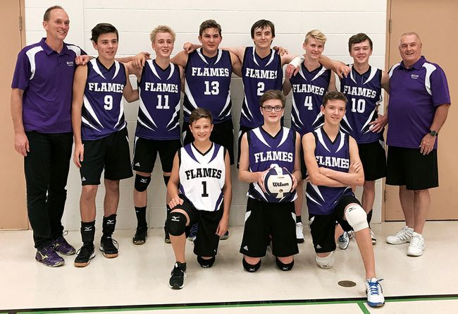 The host Flames celebrate their championship victory at the Chatham Christian senior boys' volleyball tournament Wednesday, Oct. 11, 2017. (Contributed Photo)