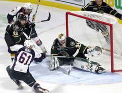 The Windsor Spitfires' Luke Boka shoots on London Knights goaltender Tyler Johnson during first-period action at Windsor's WFCU Centre on Thursday. Windsor won the game 3-1. (Postmedia)