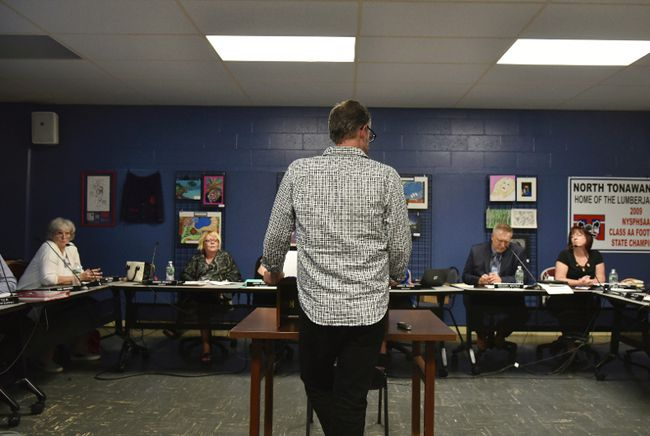 In this June 7, 2017 photo provided by Joseph Kissel, William Crago speaks before the North Tonawanda school board in North Tonawanda, N.Y., to focus their attention on the issue of bullying at the middle school. (Joseph Kissel/Niagara News Source via AP)