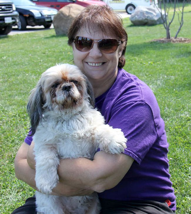 Nancy Ball, founder of CK Animal Rescue, is pictured in 2014 with her pet Shih Tzu Phoenix, who she rescued. (File photo)