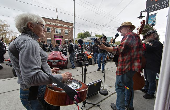 Acoustic folk trio Marr's Holler play on Main Street in Port Dover, Ontario on Friday October 13, 2017 as thousands of bikers and motorcycles descended on the Lake Erie port town for the traditional Friday the 13th Gathering. Ontario Provincial Police estimate that 110,000 people attended. Brian Thompson/Brantford Expositor/Postmedia Network