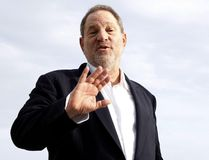 "This file photo taken on October 5, 2015 shows Harvey Weinstein, US film producer and executive producer of the TV series ""War and Peace"", posing during a photocall at the MIPCOM audiovisual trade fair in Cannes, southeastern France. New York police said on October 12, 2017 they have reopened a investigation into allegations of a 2004 sexual assault by disgraced movie mogul Harvey Weinstein. An avalanche of claims of sexual harassment, assault and rape by the Hollywood heavyweight have surfaced since the publication last week of an explosive New York Times report alleging a history of abusive behavior dating back decades. (AFP PHOTO / VALERY HACHEVALERY HACHE/AFP/Getty Images)"