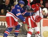 Kitchener Rangers Connor Bunnaman and Soo Greyhounds Keeghan Howdeshell tangle along the boards during first-period action on Nov. 24 at Essar Centre.