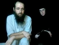 This frame grab from video provided by the Coleman family shows Caitlan Coleman and Joshua Boyle. An American woman, her Canadian husband and their three young children have been released after years held captive by a network with ties to the Taliban. (AP Photo/Coleman Family)