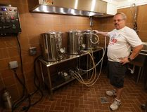 "Steve Clemens says brew rooms, like the space in his Lodi, Wis. basement, ""get a lot of attention"" when friends visit. (Morry Gash/The Associated Press)"