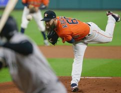 Astros starting pitcher Dallas Keuchel throws during the first inning of Game 1 of the American League Championship Series against the Yankees in Houston on Friday, Oct. 13, 2017. (Tony Gutierrez/AP Photo)