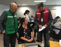 Brant County CAO Paul Emerson (left) and Michael Bradley, general manager of operations and deputy CAO, give information to Tiffany Hunter, GIS analyst, who puts them on a map during an emergency preparedness exercise in the Fire Administration Building in Paris on Friday. (Michael-Allan Marion/The Expositor)