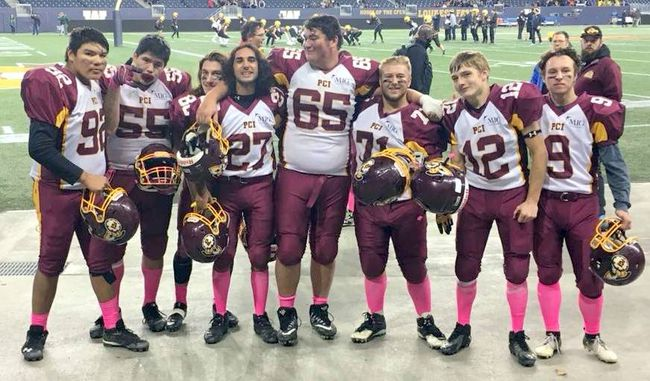 Trojan players following Friday night's victory at Investors Group Field in Winnipeg. (Facebook photo)