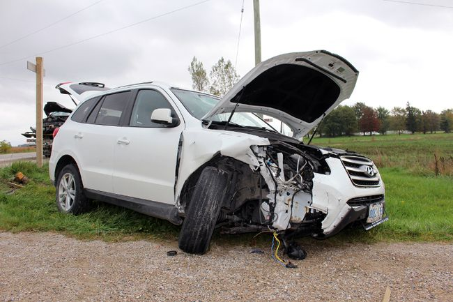 Part of the sign pointing towards Stratford was torn off near the intersection of Perth roads 119 and 121 after a two-car collision on Saturday October 14, 2017 near Stratford, Ont. Terry Bridge/Stratford Beacon Herald/Postmedia Network