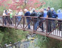 Dr. Brian Hickey, in green, leads a guided tour of the Rotary Eco-gardens which surround an artificially made creek put in 20 years ago to revitalize the ecosystem in the western edge of Lamoureux Park. Alan S. Hale/Cornwall Standard-Freeholder