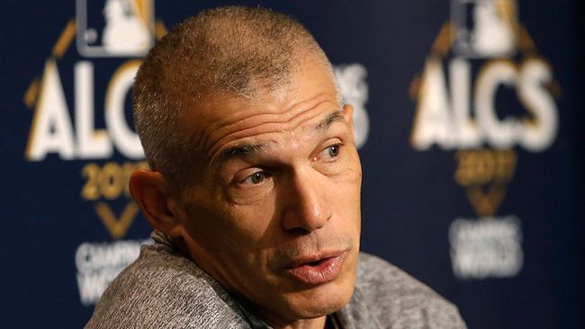 New York Yankees manager Joe Girardi reacts as he answers reporters' questions during a press conference before an American League Championship Series baseball workout day in New York, Sunday, Oct. 15, 2017.  (AP Photo/Kathy Willens)