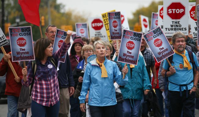 Residents march down Picton's Main Street during an anti-wind rally on Sunday October 15, 2017 in Picton, Ont. Tim Miller/Belleville Intelligencer/Postmedia Network