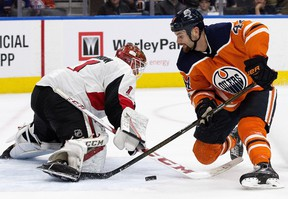 The Edmonton Oilers Zack Kassian (44) is stopped by the Ottawa Senators' goalie Mike Condon (1) during first period NHL action at Rogers Place on Saturday, Oct. 14, 2017.