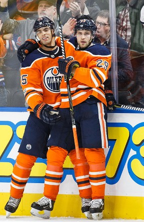 Darnell Nurse #25 and Leon Draisaitl #29 of the Edmonton Oilers celebrate Draisaitl's goal against the Winnipeg Jets at Rogers Place on October 9, 2017 in Edmonton, Canada.