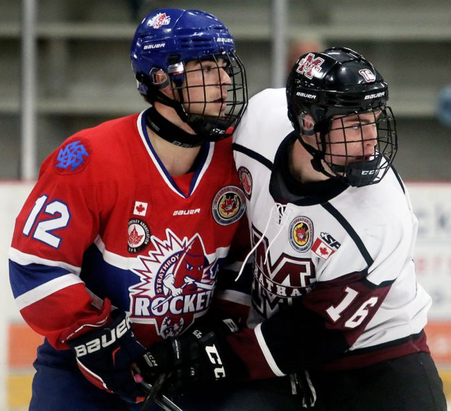 Chatham Maroons' Josh King (16) and Strathroy Rockets' Aidan Burns (12) battle in front of the Rockets' net in the third period at Chatham Memorial Arena on Sunday, Oct. 15, 2017. (MARK MALONE/The Daily News)