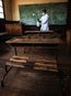 In this photo taken Tuesday Oct. 10, 2017, a member of staff at a school in Antananarivo sprays against plague in a classroom at a school in the capital Antananarivo, Madagascar, as schools remain shut due the outbreak. A plague outbreak has brought panic
