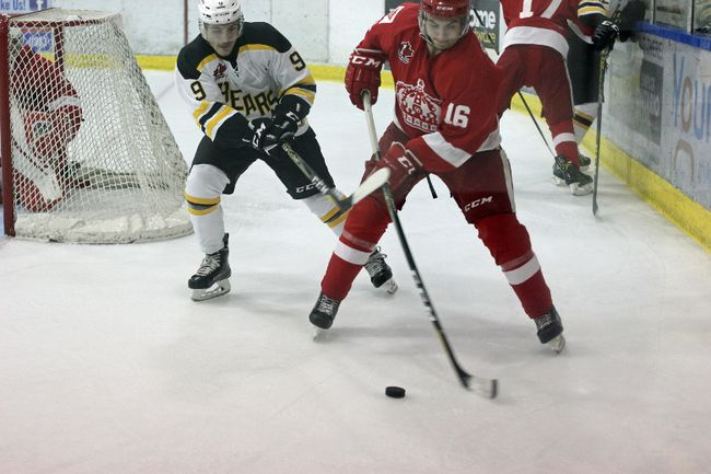 Smiths Falls Bears' Nicholas Prestia (left) sneaks up from behind Lumber Kings' Noah Rowland and crosses sticks with the Pembroke player in an attempt to regain the puck.