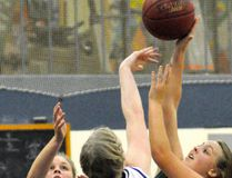 Elaine White (32) and Erica Babb of the Mitchell District High School (MDHS) senior girls basketball team epitomized tight defence in their narrow 27-26 win over Kincardine during action from the 13-team St. Michael tournament last Friday, Oct. 13 in Mitchell. ANDY BADER/MITCHELL ADVOCATE