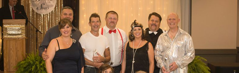 Five couples, consisting of a local 'celebrity' and a more experienced dancer, competed in the 'Dancing with the Stars' dance competition. The evening raised awareness of services available in Huron County, and also functioned as a fundraiser for Victim Services of Huron County. (Photo courtesy of Devin Sturgeon)