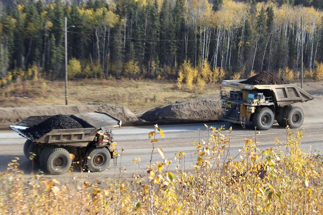 Two heavy hauler trucks cross each other near the entrance to Suncor's North Steepbank Mine, located north of Fort McMurray, Alta., on Wednesday September 27, 2017. Vincent McDermott/Fort McMurray Today/Postmedia Network