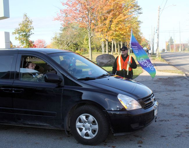 OPSEU Local 613 vice president Dave Holley trades his classroom for the picket line on Mon. Oct. 16, 2017 as 12,000 Ontario college faculty take strike action.